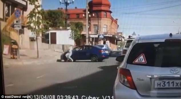 The video shows the 26-year-old woman storming away when, appallingly, the driver performs an aggressive U-turn and smashes straight into her
