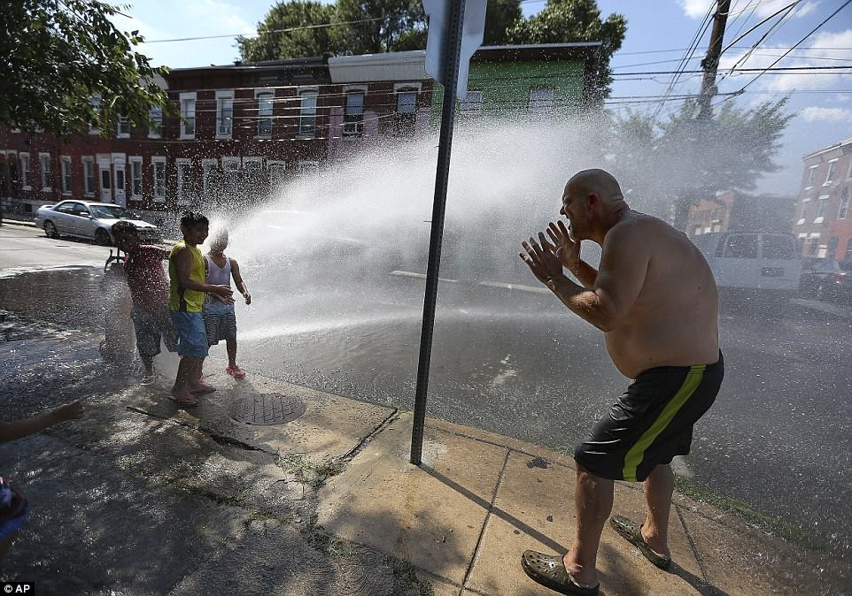 Those who plan to spend time outdoors are advised to stay hydrated and limit intake of alcoholic beverages, regardless of their health and physical activity. Al Slaughter, 58, joins neighborhood children as he tries to cool off under the fire hydrant in Philadelphia