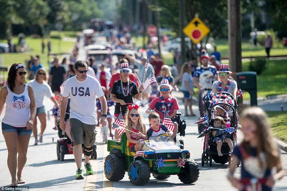 Residents of Newberry walk and ride down the road during the sixteenth annual Harper Street Parade in South Carolina