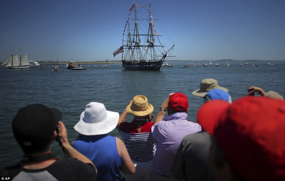 A crowd gathers to view the USS Constitution in Boston on Wednesday as it set sail in the Boston Harbor
