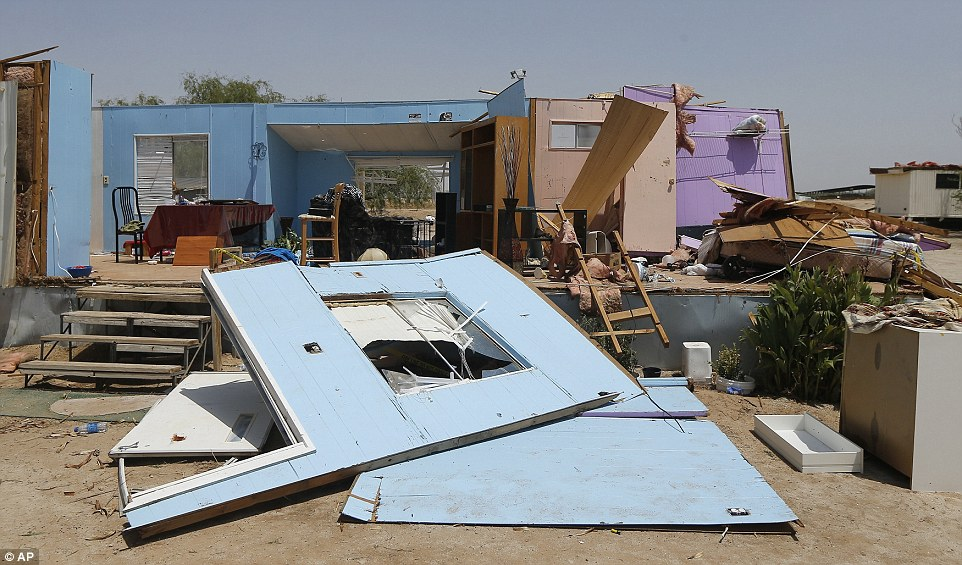 A mobile home was among those destroyed by a monsoon storm on Mondayin Buckeye, Arizona. The stormpacked thunder and lightning, high winds and sheets of rain as it caused flights to be grounded and damaged property
