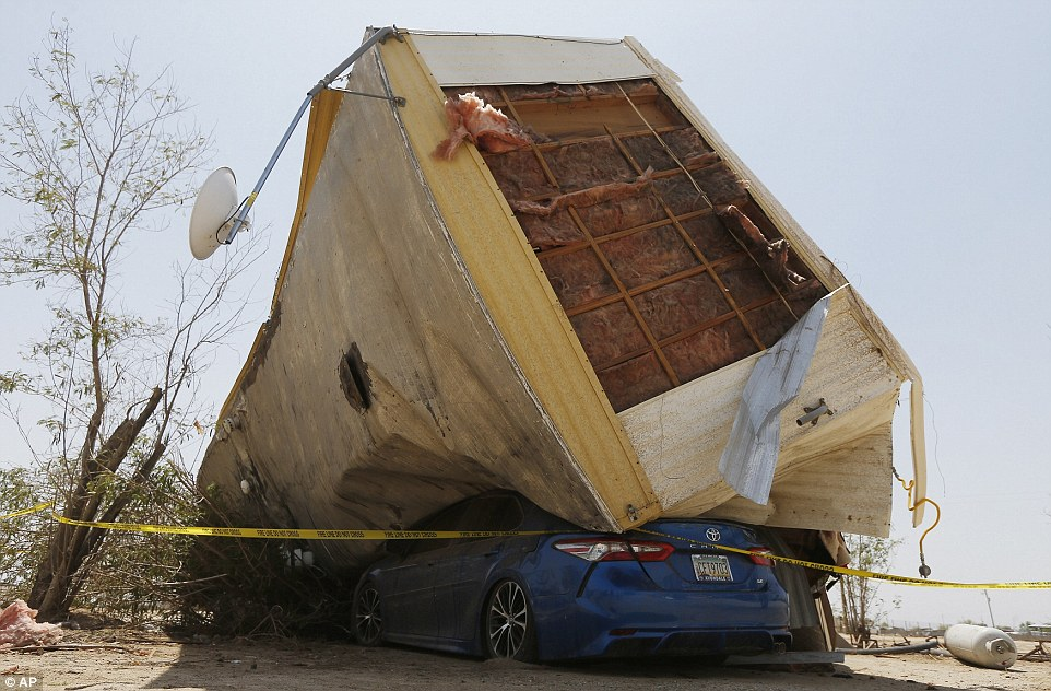 The storm sent this mobile home flying on top of a car inBuckeye on Monday.Nearly 100,000 customers were without power Monday night as a result of the storm