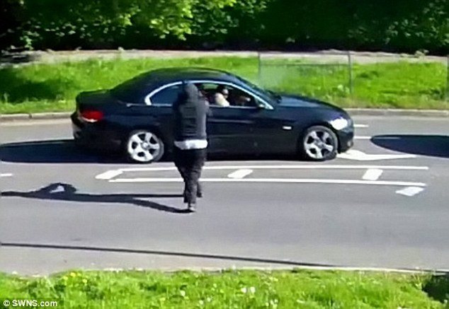 This is the moment a gunman fired three shots at a 51-year-old woman in a car in London