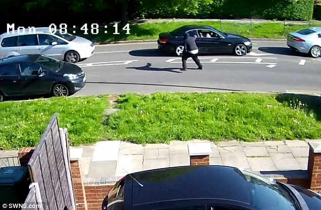 The balaclava-wearing man ran up to the side window and unloaded three shots into the car