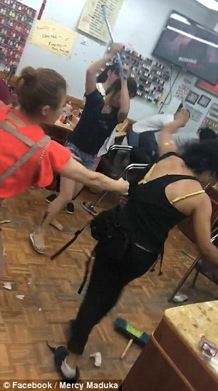 Footage captures the workers as they crowd around a customer and smack her with a broom handle at New Red Apple Nails on Norstrand Avenue in East Flatbush, Brooklyn