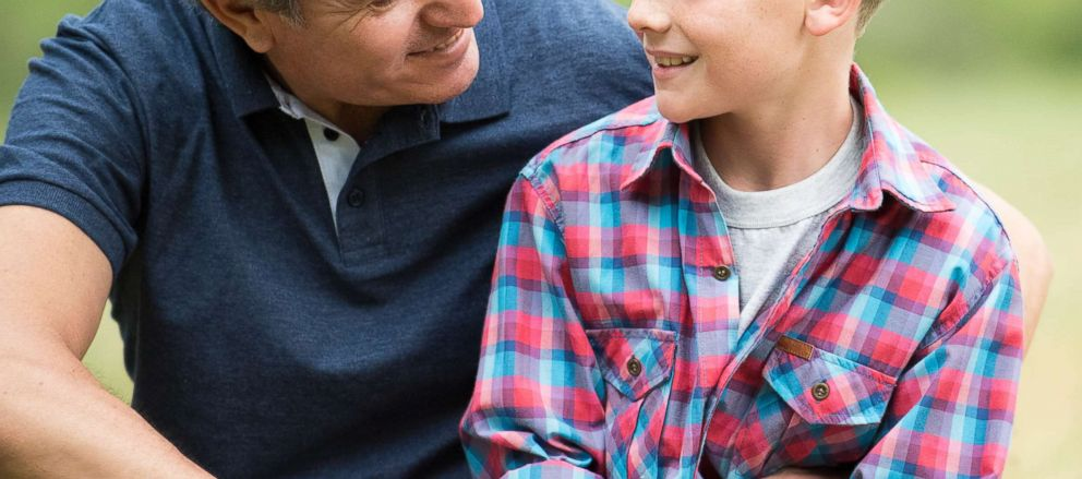 PHOTO: In this undated stock photo, a father has a conversation with his son.