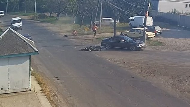 Miraculously, neither of the men on the bike seemed to be critically hurt despite the smash