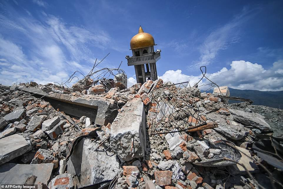 A part of a collapsed mosque is seen along with debris at Perumnas Balaroa village today