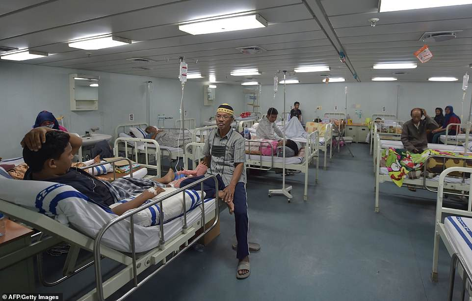 Indonesian patients get medical treatment at the floating hospital KRI Soeharso on Saturday