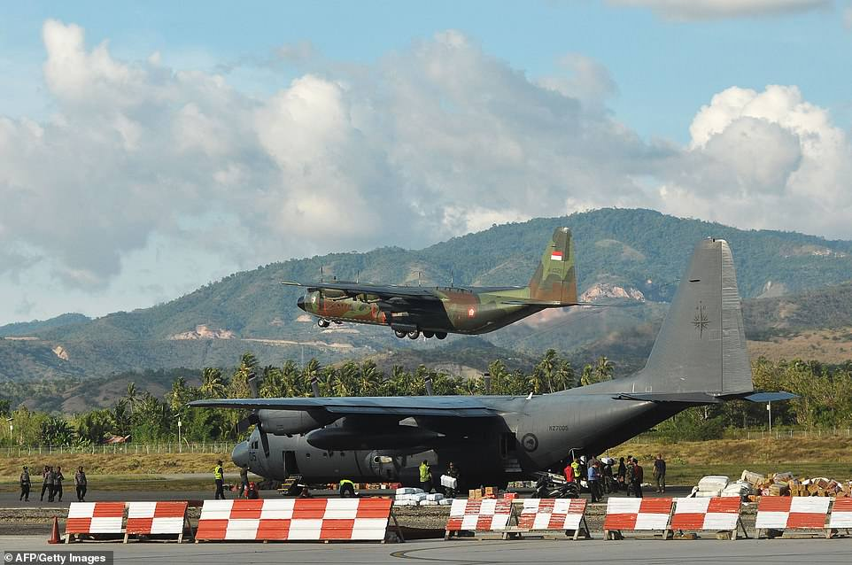 An Indonesian military airplane carrying residents of Palu leaves the Mutiara SIS Al-Jufrie Airport in Palu