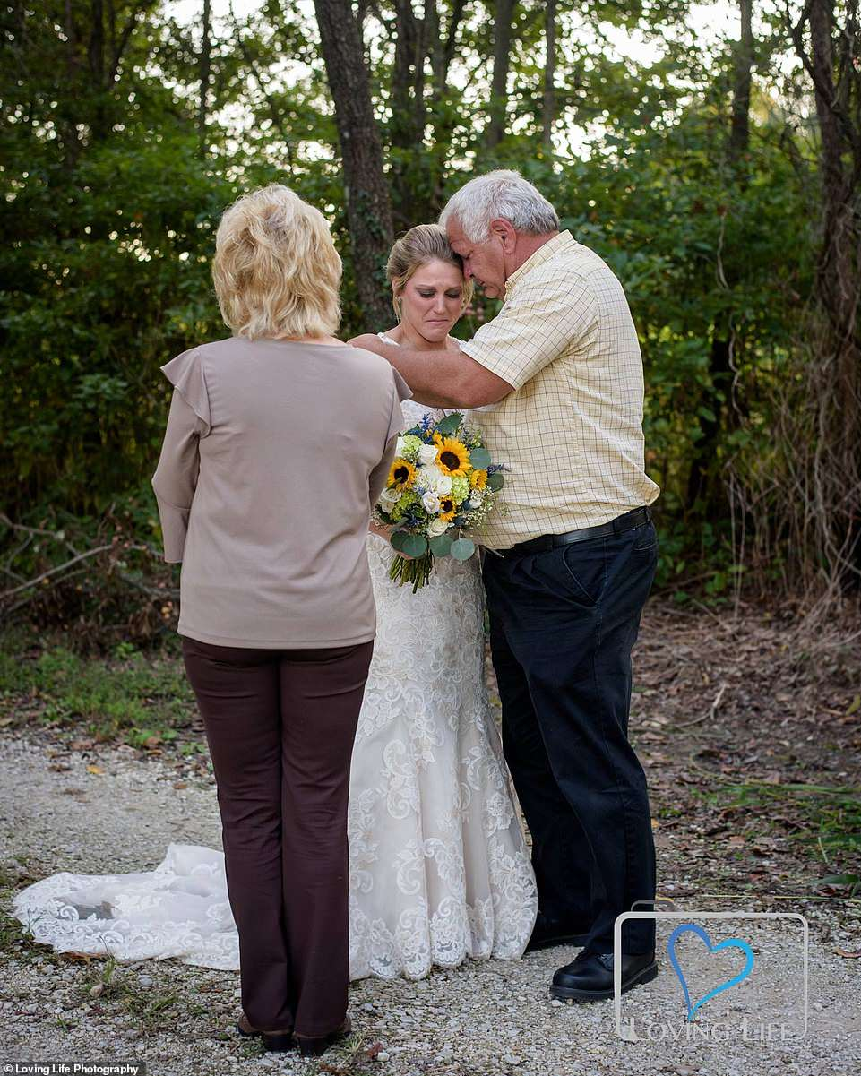 Family members console Jessica as she prepared to take photos in her wedding dress last month