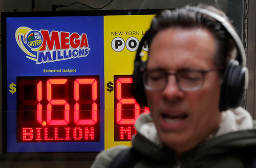 A Sign displays the jackpot for Tuesdays Mega Millions lottery drawings in New York City, U.S., October 22, 2018. REUTERS/Brendan McDermid