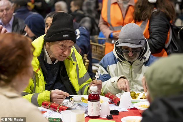 The homeless people enjoyed the food and came together with volunteers in a bid to fight loneliness and isolation at Christmas