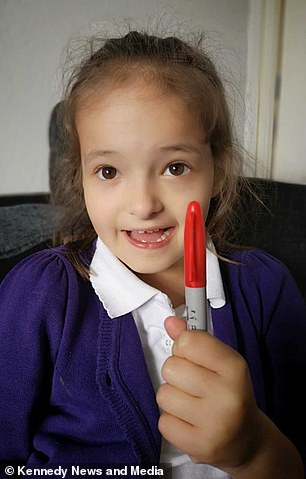 Lily Schooley, six, pictured, tried to get out of school by faking chickenpox with a red marker pen