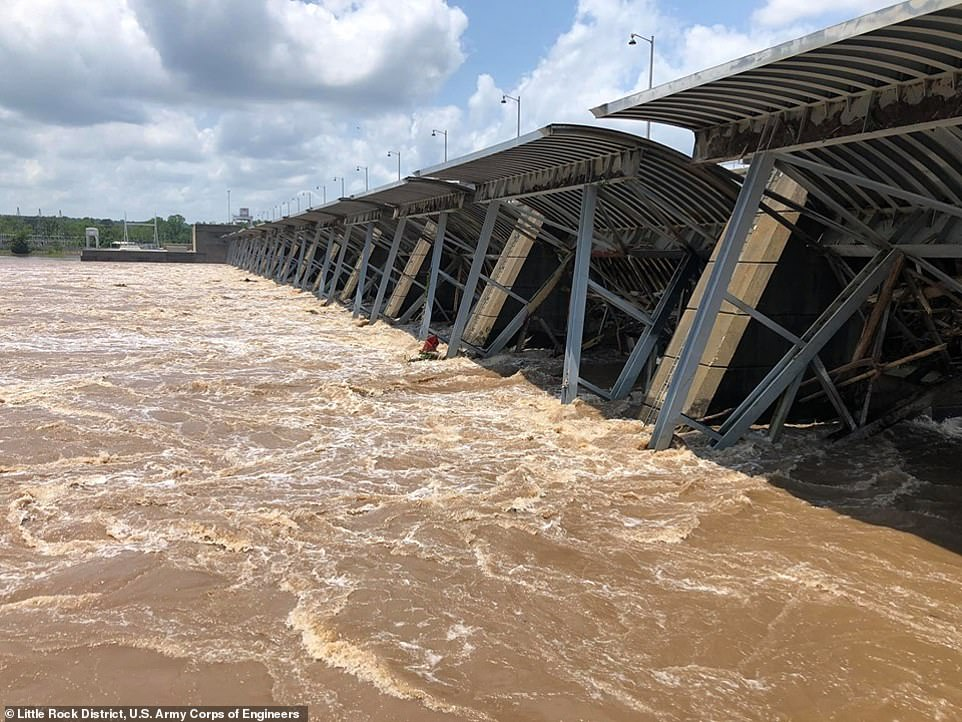 Communities along the swollen Arkansas River in Oklahoma and Arkansas (pictured is Little Rock on Wednesday) are preparing for further flooding, with the mayor of Tulsa urging thousands of residents behind the city's aging levees to be ready to evacuate in the event of a 'worst-case scenario'