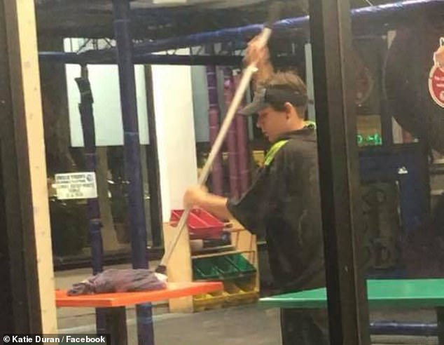 Stomach-turning: Burger King patron Katie Duran on June 6 recorded a video showing a worker at the eatery on State Road 13 mopping table tops