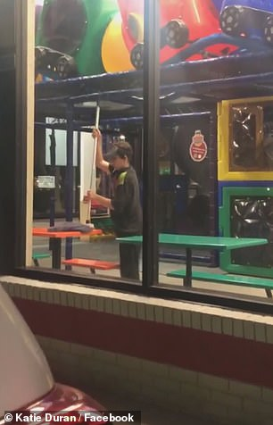 Duran's video shows the staffer using a grimy-looking mop to clean a table in the Burger King's play area where the woman and her family had just eaten