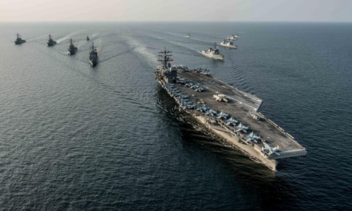 , USS Ronald Reagan (CVN 76), steams in formation with ships from Carrier Strike Group Five (CSG) 5 and the Republic of Korea Navy (ROKN) during exercise Invincible Spirit. Photo: US Navy