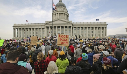 Protesters on the steps of the Utah State Capitol on December 2, 2017 during a rally to protest the shrinking of two national monument areas in the state by the trump administration. REUTERS/Emily Means